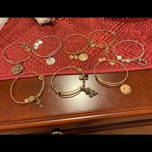 Eight Alex and ani bracelets.